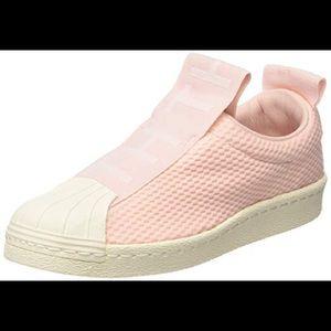 Pink adidas slip on superstars